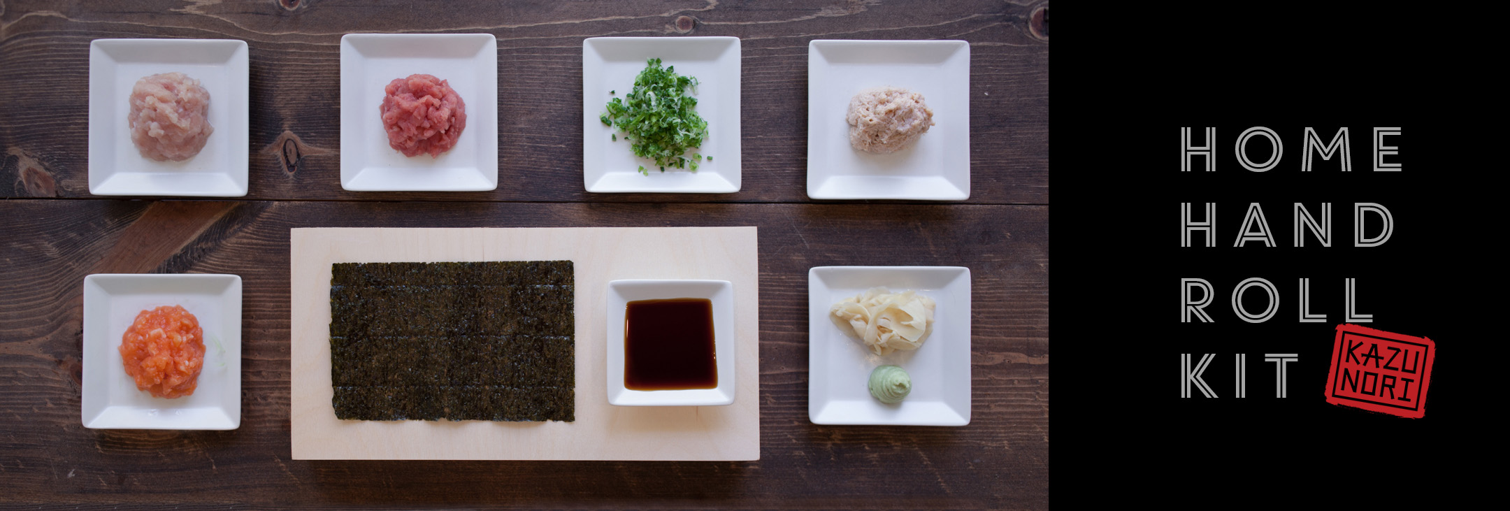 Home hand roll kit ingredients on white dishes