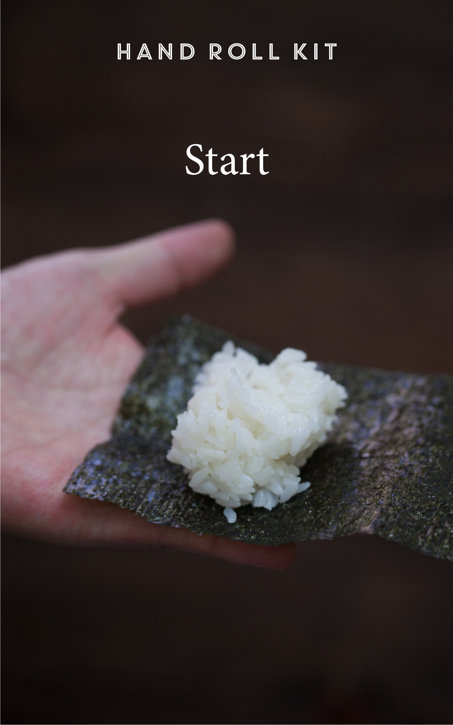 Photo of hand holding nori with rice on top