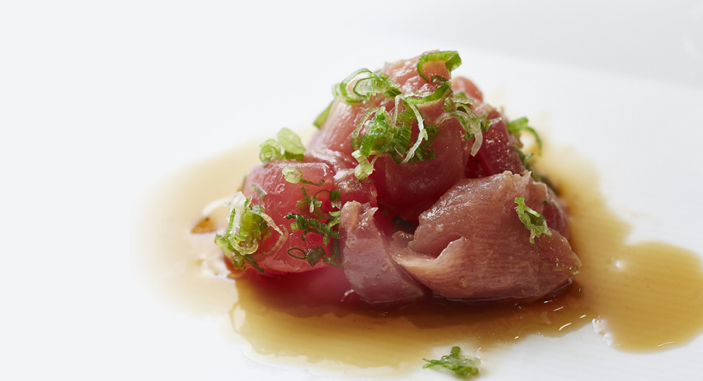 Tuna sashimi with scallions and soy sauce